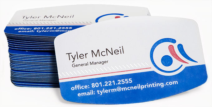 Stack of business cards printed at McNeil Printing in Orem, Utah